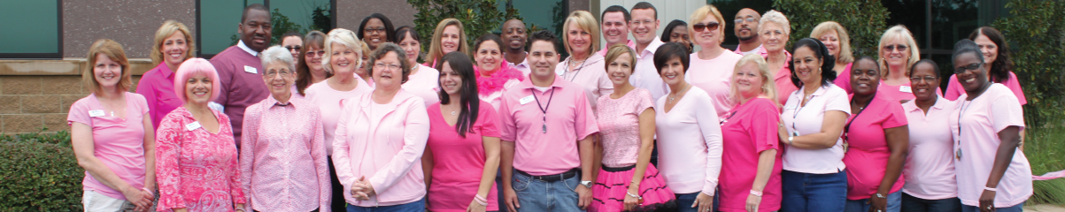 First Commerce Team Members standing outside supporting breast cancer awareness month